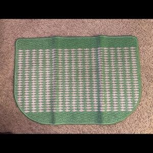 Green and beige door mat